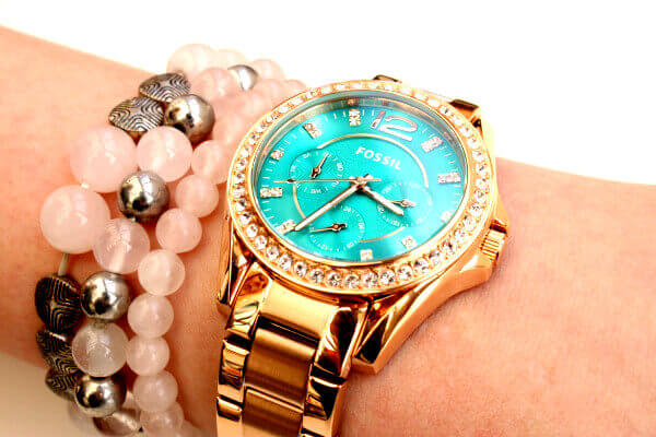 Luxury gold watch with some pearl bracelets